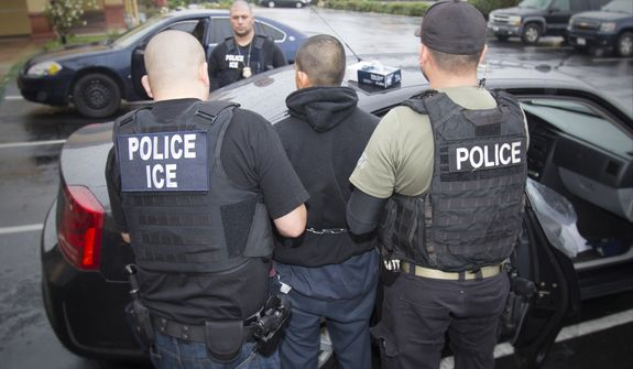 In this Tuesday, Feb. 7, 2017, photo released by U.S. Immigration and Customs Enforcement shows foreign nationals being arrested this week during a targeted enforcement operation conducted by U.S. Immigration and Customs Enforcement (ICE) aimed at immigration fugitives, re-entrants and at-large criminal aliens in Los Angeles. (Charles Reed/U.S. Immigration and Customs Enforcement via AP) ** FILE **