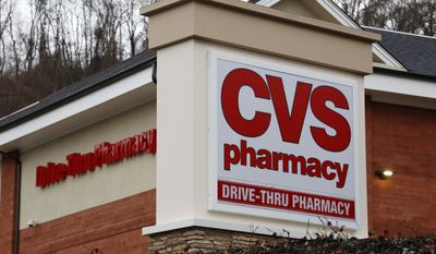 FILE - This Jan. 18, 2017, file photo shows a CVS Pharmacy in Pittsburgh. CVS Health Corp. reports earnings, Thursday, Feb. 8, 2018. (AP Photo/Gene J. Puskar, File)