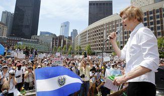 Sen. Elizabeth Warren, D-Mass., speaks at the Rally Against Separation Saturday, June 30, 2018, in Boston. (AP Photo/Winslow Townson)