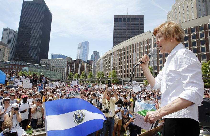 Sen. Elizabeth Warren, D-Mass., speaks at the Rally Against Separation Saturday, June 30, 2018, in Boston. (AP Photo/Winslow Townson)
