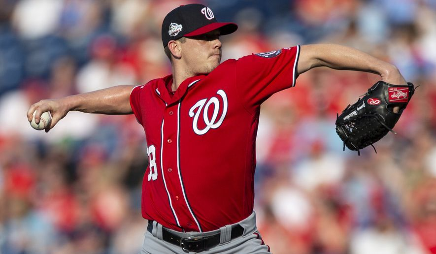 Washington Nationals starting pitcher Jeremy Hellickson (58) throws during the first inning of a baseball game against the Philadelphia Phillies, Saturday, June 30, 2018, in Philadelphia. (AP Photo/Laurence Kesterson)
