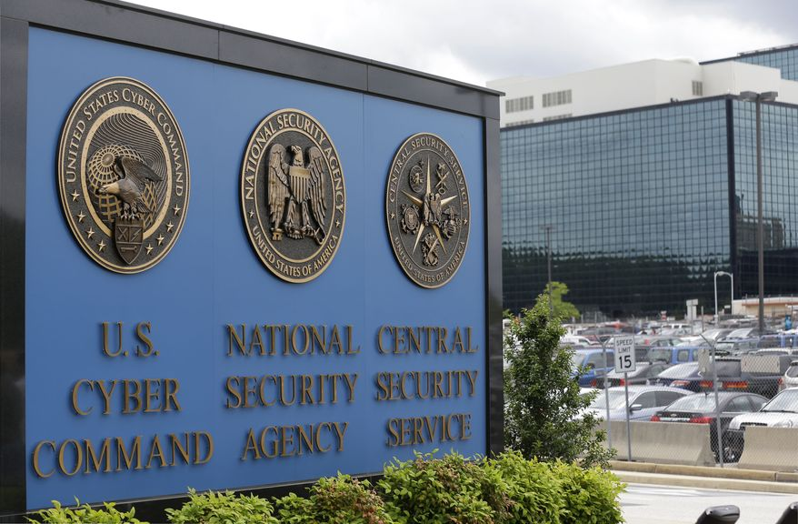 In this June 6, 2013, file photo, a sign stands outside the National Security Agency (NSA) campus in Fort Meade, Md. (AP Photo/Patrick Semansky, File)