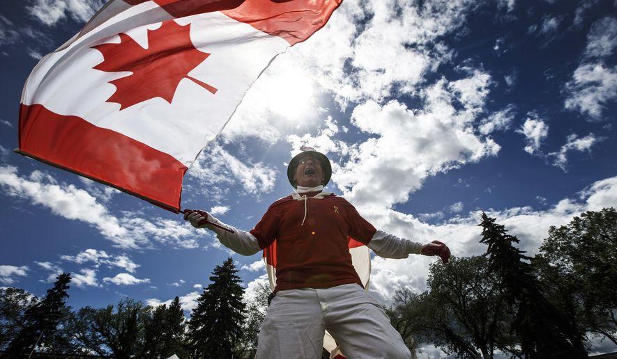 Henry Stephens celebrates Canada day in Edmonton Alta, on Sunday July 1, 2018. (Jason Franson/The Canadian Press via AP)