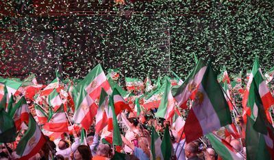 The National Council of Resistance of Iran, a well-connected group that has found new prominence and influence in the strongly anti-Iran Trump administration, rallied in Paris on Saturday. (Sarah Wachter/Special to The Washington Times)