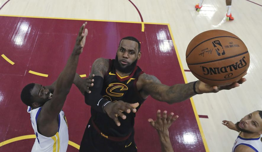 Cleveland Cavaliers' LeBron James shoots against Golden State Warriors' Draymond Green during the first half of Game 3 of basketball's NBA Finals. (Gregory Shamus/Pool Photo via AP, File)