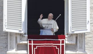 Pope Francis blesses the crowd as he recites the Angelus noon prayer from the window of his studio overlooking St. Peter's Square, at the Vatican, Sunday, July 1, 2018. Pope Francis has lamented intensified attacks in southern Syria, asking that people be spared more suffering.  (AP Photo/Alessandra Tarantino)