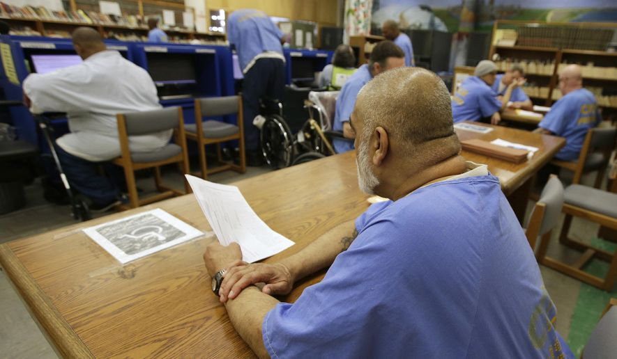 In this file photo taken June 20, 2018, inmates use the library at the California Medical Facility in Vacaville, Calif. . (AP Photo/Rich Pedroncelli) **FILE**