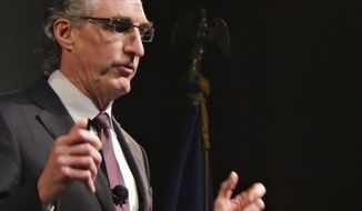 HOLD FOR STORY - FILE - In this Jan. 23, 2018, file photo, North Dakota Gov. Doug Burgum delivers his state of the state address in Minot.N.D. A state audit this week has concluded that North Dakota's governor, lieutenant governor, office staff and first lady used state airplanes for in-state trips with questionable purposes and for out-of-state trips where cheaper commercial flights were available. The governor's office defends its use of state planes. (Kim Fundingsland/The Minot Daily News via AP, File)