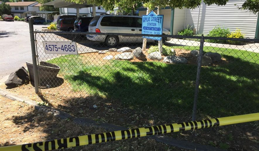 Police tape blocks off an area at a Boise, Idaho, apartment complex, Sunday, July 1, 2018, where nine people were stabbed during an attack that targeted a child's birthday party the night before. (AP Photo/Rebecca Boone)