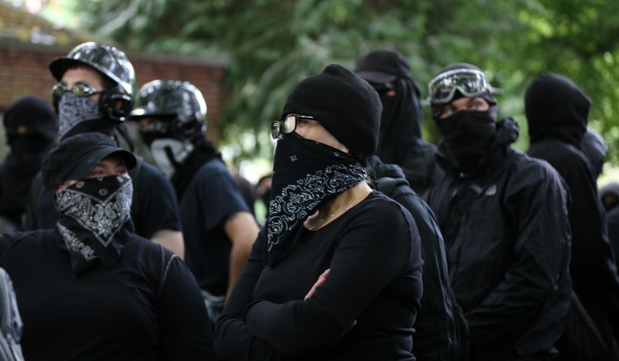 Antifa members gather at a rally held by Patriot Prayer in Portland, Ore., on Saturday, June 30, 2018. Police dispersed clashing protesters as problems occurred when the two opposing protest groups — Patriot Prayer and antifa — took to the streets.  (Mark Graves/The Oregonian via AP)