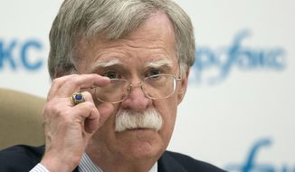 FILE - In this June 27, 2018, file photo, U.S. National security adviser John Bolton listens to question as speaks to the media after his talks with Russian President Vladimir Putin in Moscow, Russia. Bolton said Sunday, July 1, the U.S. has a plan that would lead to the dismantling of North Korea's nuclear weapons and ballistic missile programs in a year. (AP Photo/Alexander Zemlianichenko, File)