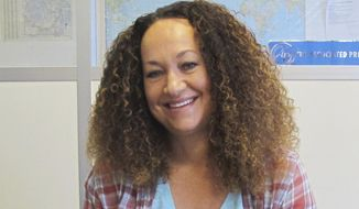 FILE - In this March 20, 2017, file photo, Nkechi Diallo, then known as Rachel Dolezal, poses at the bureau of The Associated Press in Spokane, Wash. The former NAACP leader in Washington state, whose life unraveled after she was exposed as a white woman pretending to be black, has pleaded not guilty to charges involving welfare fraud. Diallo entered the plea last week. (AP Photo/Nicholas K. Geranios, File)