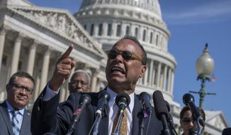 "Rep. Luis Gutierrez, D-Ill., a leading advocate in the House for immigration reform, joins supporters of ""dreamers"" as they mark the 6th anniversary of the announcement of the Deferred Action for Childhood Arrivals (DACA) program, on Capitol Hill in Washington, Friday, June 15, 2018. (AP Photo/J. Scott Applewhite) ** FILE **"