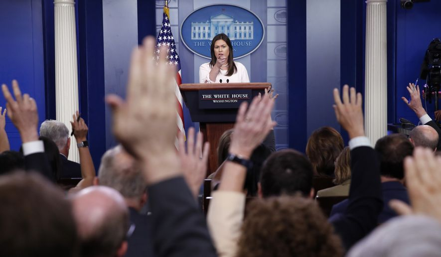 White House press secretary Sarah Huckabee Sanders points to a reporter for a question during a press briefing at the White House, Monday, July 2, 2018, in Washington. (AP Photo/Alex Brandon)