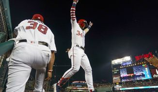 Washington Nationals' Bryce Harper celebrates a single home run during the eighth inning of a baseball game against the Boston Red Sox at Nationals Park, Monday, July 2, 2018, in Washington. (AP Photo/Andrew Harnik)