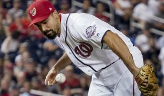 Washington Nationals third baseman Anthony Rendon (6) loses control of a ball and can't make a play on bunt to third during the ninth inning of a baseball game against the Boston Red Sox at Nationals Park, Monday, July 2, 2018, in Washington. (AP Photo/Andrew Harnik)