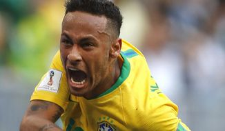 Brazil's Neymar celebrates after scoring his side's opening goal during the round of 16 match between Brazil and Mexico at the 2018 soccer World Cup in the Samara Arena, in Samara, Russia, Monday, July 2, 2018. (AP Photo/Frank Augstein) **FILE**