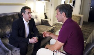 """In this June 30, 2018, photo provided by ABC News, Michael Cohen, left, President Donald Trump's longtime personal lawyer and fixer, is interviewed by ABC's George Stephanopoulos during an off-camera interview in New York at the hotel where Cohen has been staying. In his first interview since federal agents raided his home and hotel room three months earlier as part of an investigation into his business dealings, Cohen made clear that protecting Trump is not his priority. """"My wife, my daughter and my son have my first loyalty and always will,"""" Cohen told Stephanopoulos, ''I put family and country first."""" (ABC News via AP)"""