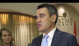 In this Aug. 22, 2017, file photo, U.S. Rep. Kevin Yoder, R-Kan., speaks with reporters before a town hall meeting in the Olathe, Kan. Mr. Yoder serves as chairman of the House homeland security spending subcommittee. (AP Photo/John Hanna, File)