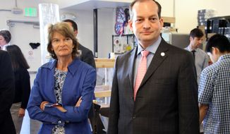 U.S. Sen. Lisa Murkowski, left, and Labor Secretary Alexander Acosta, right, tour the Cook Inlet Tribal Council Employment and Training Center on Monday, July 2, 2018, in Anchorage, Alaska. Acosta is traveling in Alaska this week, and said during a Sunday stop in Fairbanks that Alaska's economy should pick up given an increase in military spending and pro-energy policies of the Trump administration. (AP Photo/Mark Thiessen)