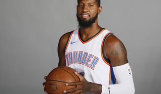FILE - In this Sept. 25, 2017, file photo, Oklahoma City Thunder forward Paul George is pictured during an NBA basketball media day in Oklahoma City. George has decided not to exercise his $20.7 million option for next season with the Oklahoma City Thunder, a person with knowledge of the situation said Thursday. George will become an unrestricted free agent on Sunday. The person spoke to The Associated Press on condition of anonymity Thursday, June 28, 2018, because neither George nor the team has publicly announced his decision. (AP Photo/Sue Ogrocki, File)