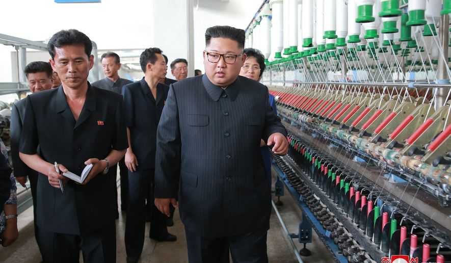 "In this undated photo provided on July 2, 2018, by the North Korean government, North Korean leader Kim Jong Un, center, visits Sinuiju Chemical Fibre Mill in Sinuiju, North Korea. Independent journalists were not given access to cover the event depicted in this image distributed by the North Korean government.  The content of this image is as provided and cannot be independently verified. Korean language watermark on image as provided by source reads: ""KCNA"" which is the abbreviation for Korean Central News Agency. (Korean Central News Agency/Korea News Service via AP)"