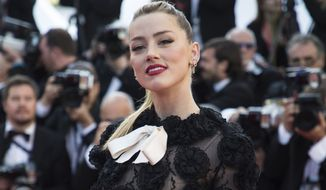 Actress Amber Heard poses for photographers upon arrival at the premiere of the film 'Girls of The Sun' at the 71st international film festival, Cannes, southern France, Saturday, May 12, 2018. (Photo by Vianney Le Caer/Invision/AP)