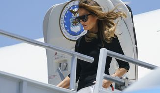 First lady Melania Trump arrives at Phoenix Sky Harbor International Airport, in Phoenix, Thursday, June 28, 2018. The first lady is en route to Southwest Key Campbell, a shelter for children that have been separated form their parents. (AP Photo/Carolyn Kaster)