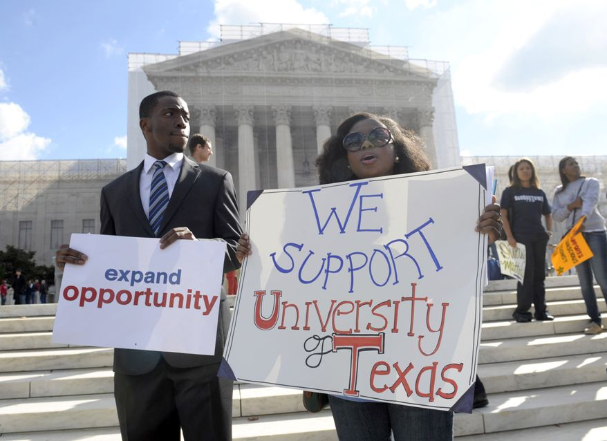 Jheanelle Wilkins of New Castle, Del., right, and Neo Moneri of Beltsville, Md., participate in a rally outside the Supreme Court in Washington, Wednesday, Oct. 10, 2012, supporting the University of Texas.. The Supreme Court is taking up a challenge to a University of Texas program that considers race in some college admissions. The case could produce new limits on affirmative action at universities, or roll it back entirely. (AP Photo/Susan Walsh) **FILE**