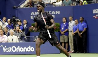 FILE- In this Tuesday, Aug. 29, 2017 file photo, Frances Tiafoe, of the United States, reacts after breaking Roger Federer, of Switzerland, during a first-round match of the U.S. Open tennis tournament, in New York. Tiafoe saved 13 of the 15 break points he faced to upset 30th-seeded Fernando Verdasco in the first round of Wimbledon on Tuesday, July 3, 2018. (AP Photo/Julio Cortez, File) **FILE**