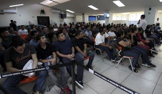 In this June 28, 2018 photo, Salvadoran deportees arriving from McAllen, Texas, listen to instructions from an immigration officer at La Chacra Immigration Center in San Salvador, El Salvador. Very few gang members try to get into the United States. In fiscal year 2017, the U.S. Border Patrol carried out 310,531 detentions of people who were in the U.S. illegally, but only 0.09 percent of them belonged to the gangs operating in Central America, according to U.S. Customs and Border Protection statistics. (AP Photo/Salvador Melendez)