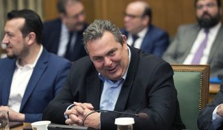 In this Tuesday, April 3, 2018 file photo Greek Defense Minister Panos Kammenos takes part in cabinet meeting in Athens. Kammenos said Tuesday, June 3, 2018, that he will not allow a deal recently made with neighboring Macedonia over the its name to be ratified without voter approval, either through general elections or through a referendum. (AP Photo/Petros Giannakouris, file)