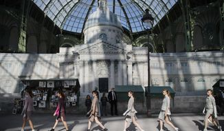 Models wear creations for the Chanel Haute Couture Fall-Winter 2018/2019 fashion collection presented Tuesday, July 3, 2018 in Paris. (AP Photo/Francois Mori)