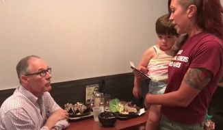 Environmental Protection Agency Administrator Scott Pruitt was confronted and asked to resign by a mother holding her 2-year-old son at a D.C. restaurant Monday. (Facebook/@Kristin Mink)