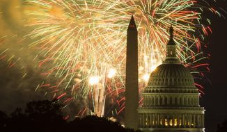 In this July 4, 2014, file photo, fireworks illuminate the sky over the U.S. Capitol building and the Washington Monument during Fourth of July celebrations in Washington. (AP Photo/Evan Vucci, File)