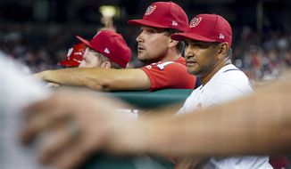 Washington Nationals manager Dave Martinez (4), right, and Ryan Zimmerman, center, stand in the dugout during a baseball game against the Boston Red Sox at Nationals Park, Monday, July 2, 2018, in Washington. (AP Photo/Andrew Harnik)