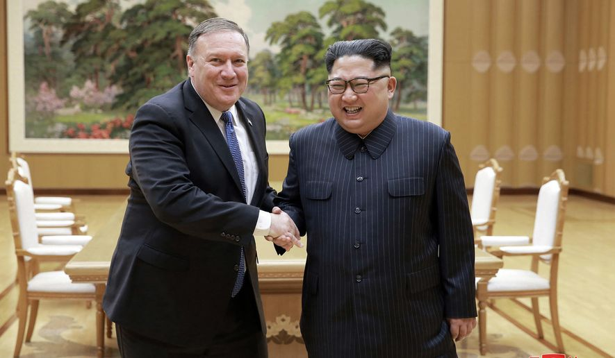 """FILE - In this May 9, 2018, file photo provided by the North Korean government, U.S. Secretary of State Mike Pompeo, left, shakes hands with North Korean leader Kim Jong Un during a meeting at Workers' Party of Korea headquarters in Pyongyang, North Korea. In his first post-summit visit to Pyongyang on Friday, July 6, 2018, Pompeo is hoping to pin Kim down on all the things the North Korean leader danced around in his talks with U.S. President Donald Trump in Singapore.Korean language watermark on image as provided by source reads: """"KCNA"""" which is the abbreviation for Korean Central News Agency. (Korean Central News Agency/Korea News Service via AP, File)"""