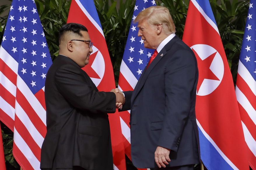 In this June 12, 2018, file photo, U.S. President Donald Trump, right, shakes hands with North Korean leader Kim Jong-un at the Capella resort on Sentosa Island in Singapore. (AP Photo/Evan Vucci, File)