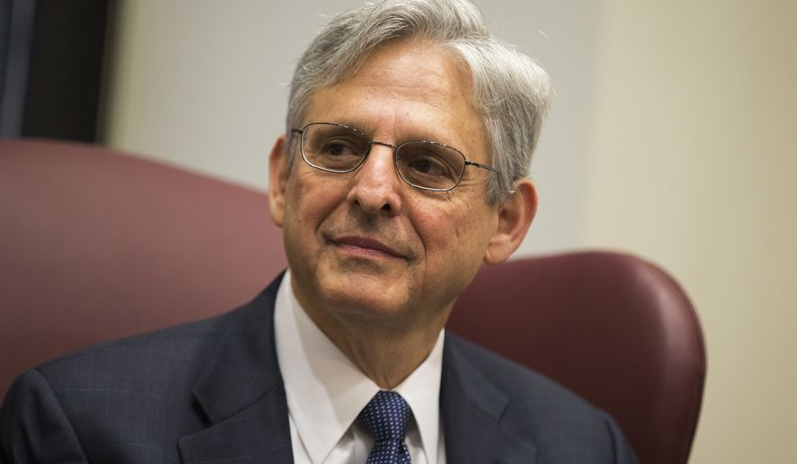 In this April 28, 2016, file photo, Judge Merrick Garland, President Barack Obama's choice to replace the late Justice Antonin Scalia on the Supreme Court meets with Sen. Gary Peters, D-Mich., on Capitol Hill in Washington. Garland will submit a questionnaire detailing his credentials and experience to the Senate Judiciary Committee on Tuesday, May 10, taking another step in the White House's push to break the Senate blockade on his nomination. (AP Photo/Evan Vucci) **FILE**