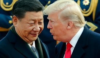 FILE - In this Nov. 9, 2017, file photo, U.S. President Donald Trump, right, chats with Chinese President Xi Jinping during a welcome ceremony at the Great Hall of the People in Beijing. Critics fear foreign government favors to Trump businesses have become business as usual. Ethics watchdogs say apparent quid-pro-quo deals are not being stopped by a Republican-led Congress or the courts. (AP Photo/Andy Wong, File)