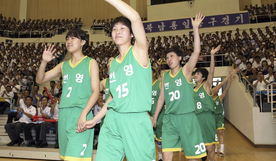 "In this July 4, 2018, photo, South and North Korean players of Team Prosperity wave as they arrive to play in a friendly basketball game at Ryugyong Jong Ju Yong Gymnasium in Pyongyang, North Korea. Their uniforms read: "" Prosperity."" (Korea Pool via AP)"