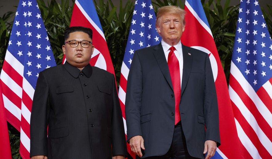 FILE - In this June. 12, 2018, file photo, U.S. President Donald Trump, right, stands with North Korean leader Kim Jong Un during a meeting on Sentosa Island, in Singapore. Diplomacy aimed at ending the North Korean nuclear crisis has produced little tangible progress since the historic June 12 summit between Trump and Kim. (AP Photo/Evan Vucci, File)