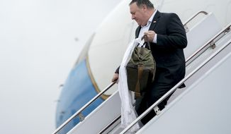 Secretary of State Mike Pompeo arrives at Yokota Air Force Base, at Fussa, Japan, Friday, July 6, 2018, for a refueling stop on his way to Pyongyang, North Korea. Pompeo begins a trip traveling to North Korea, Japan, Vietnam, Abu Dhabi, and Brussels. (AP Photo/Andrew Harnik, Pool)