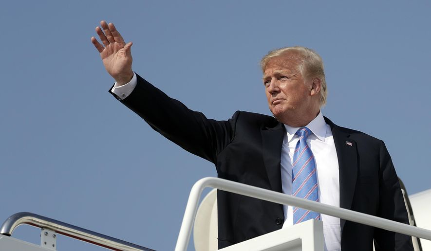 FILE - In this July 3, 2018 file photo President Donald Trump waves as he boards Air Force One at Andrews Air Force Base, Md. U.S. Sen. Jon Tester is giving Trump a tongue-in-cheek welcome to Montana by taking out a full-page ad in 14 newspapers thanking the president for signing 16 bills that the Democrat sponsored or co-sponsored. Trump was scheduled to hold a rally Thursday, July 5, 2018, in Great Falls to campaign for Tester's Republican challenger, State Auditor Matt Rosendale. The president has made the Montana Senate race a priority after he blamed Tester for derailing the nomination of his first Veterans Affairs nominee, White House physician Ronny Jackson. (AP Photo/Evan Vucci, File)