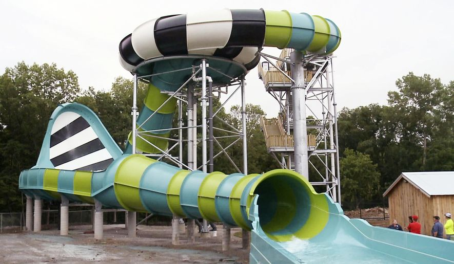 """This June 22, 2018, photo from video provided by KSDK-TV shows the new water slide Typhoon Twister at Six Flags St. Louis. No government officials conducted a safety inspection of a new waterslide at Six Flags St. Louis before a woman said she suffered whiplash last month from the force of the """"Typhoon Twister"""" that featured a five-story drop and a """"45-foot zero gravity wave wall."""" (KSDK-TV via AP)"""