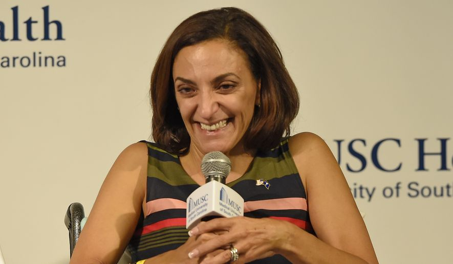 State Rep. Katie Arrington, a Republican candidate for Congress, speaks to the media Friday, July 6, 2018, at the MUSC campus in Charleston, S.C. Arrington, 47, was a passenger in a car that was hit head-on by a wrong-way driver June 22 on U.S. Highway 17 near Charleston. (AP Photo/Richard Shiro)