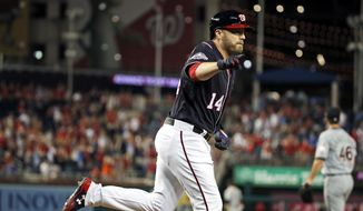 Washington Nationals' Mark Reynolds (14) runs the bases after his walkoff home run during the ninth inning of a baseball game as Miami Marlins relief pitcher Kyle Barraclough (46) watches the ball at Nationals Park, Friday, July 6, 2018, in Washington. (AP Photo/Alex Brandon)
