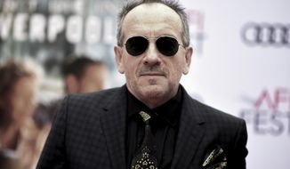 "In this Sunday, Nov. 12, 2017 file photo, musician Elvis Costello attends a screening of ""Film Stars Don't Die in Liverpool"" during the 2017 AFI Fest at the TCL Chinese Theatre in Los Angeles. Costello has canceled the rest of his European summer tour after undergoing surgery for a ""small but very aggressive"" cancerous tumor. The post-punk singer-songwriter says he needs time to recover after the operation. The 63-year-old musician said in a statement Friday, July 6, 2018 that he initially thought ""normal service had been resumed"" but now realized he needed more rest. (Photo by Richard Shotwell/Invision/AP, File)"