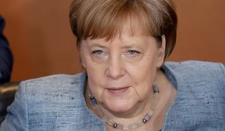 German Chancellor Angela Merkel attends the weekly cabinet meeting at the chancellery in Berlin, Germany, Friday, July 6, 2018. (AP Photo/Michael Sohn)