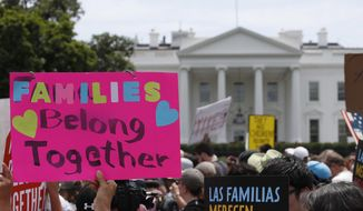 In this June 20, 2018, file photo, activists march past the White House to protest the Trump administration's approach to illegal border crossings and separation of children from immigrant parents in Washington. (AP Photo/Alex Brandon, file)